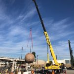 Large storage tank removed by crane
