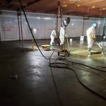 Workers cleaning up after asbestos removal