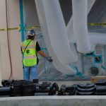 Worker supervising asbestos abatement process