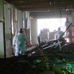 Construction workers doing internal demolition and asbestos abatement