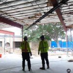 Construction workers inside school after asbestos abatement and interior demolition