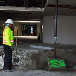 Worker doing concrete removal and interior demolition